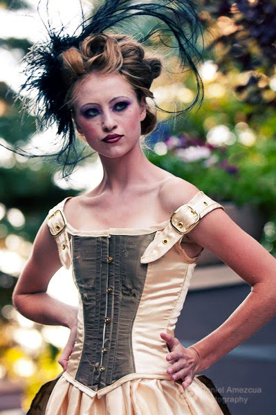 This steampunk bridal dress features a steel boned corseted bodice and a