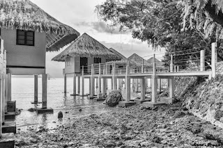 The huts at the Apulit Island Resort are built on stilts and stand directly on top of the water.