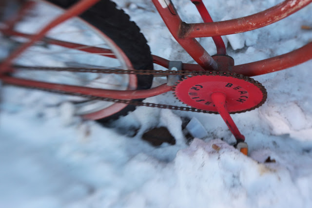 A rusty, pinky beach cruiser parked in the snow in Golden, Colorado. Shot with a Lensbaby Composer.