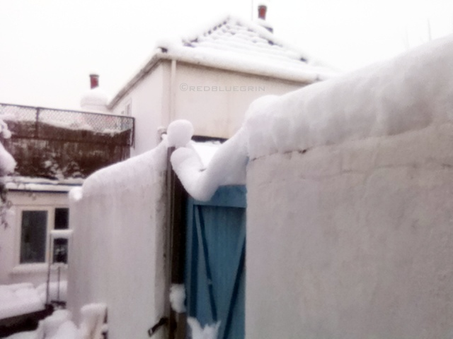 A gate holding layers of snow, Brighton, UK