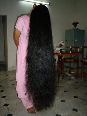 Bengali long hair model combing her hair.