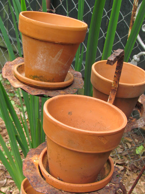 empty clay pots ready for filling