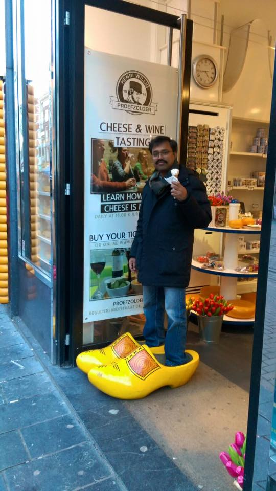 Man on the famous wooden slippers in Amsterdam