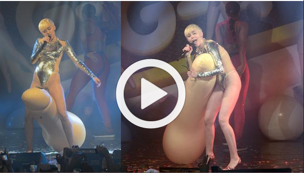 Miley Cyrus rides giant penis on Stage