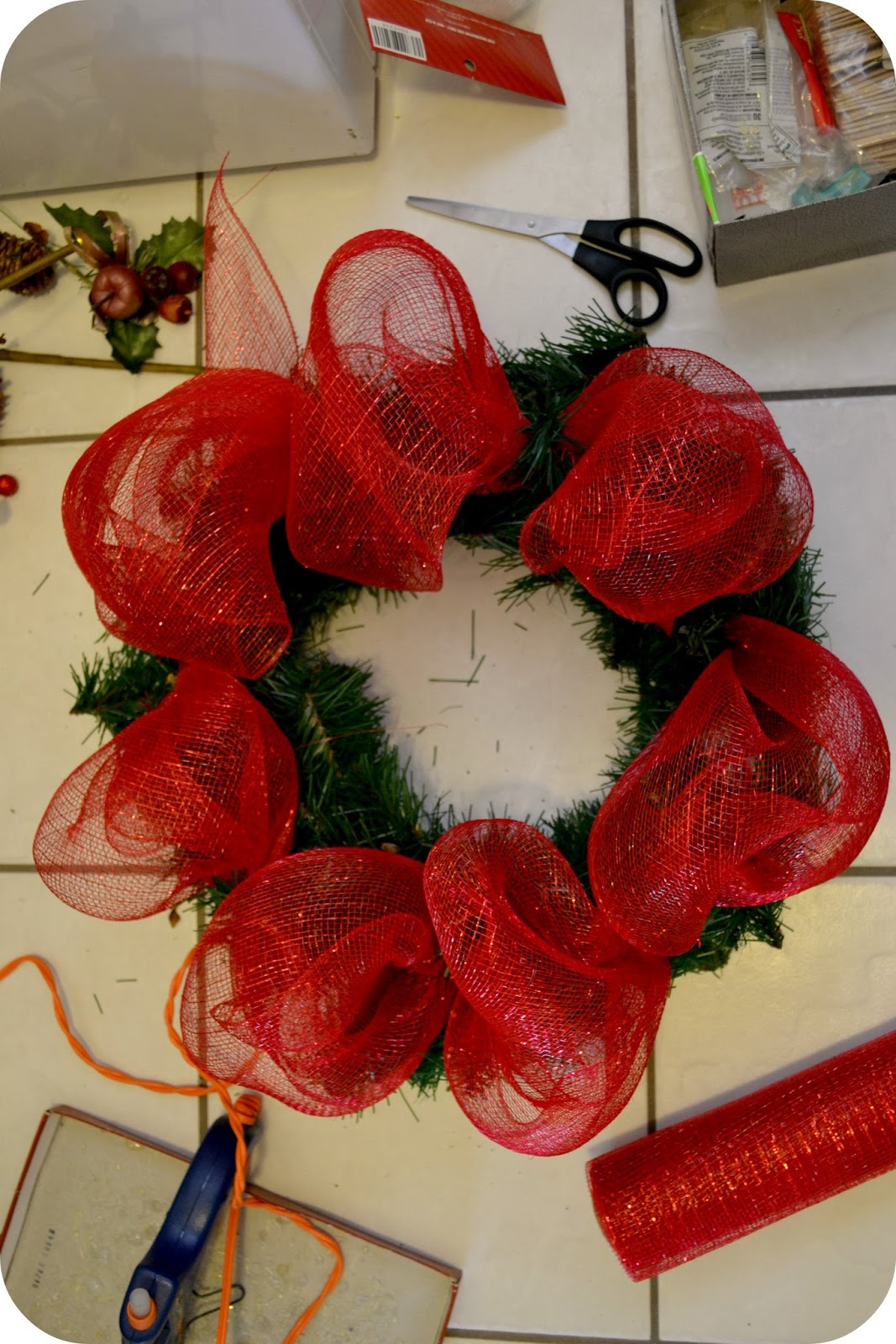 The sparacino chronicles christmas deco mesh wreath tutorial i fired up my hot glue gun and glued the glittery ornaments on the wreath i also had some red glittery sticks with balls on them and some decorative leaves baditri Gallery