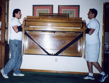 Men lifting piano
