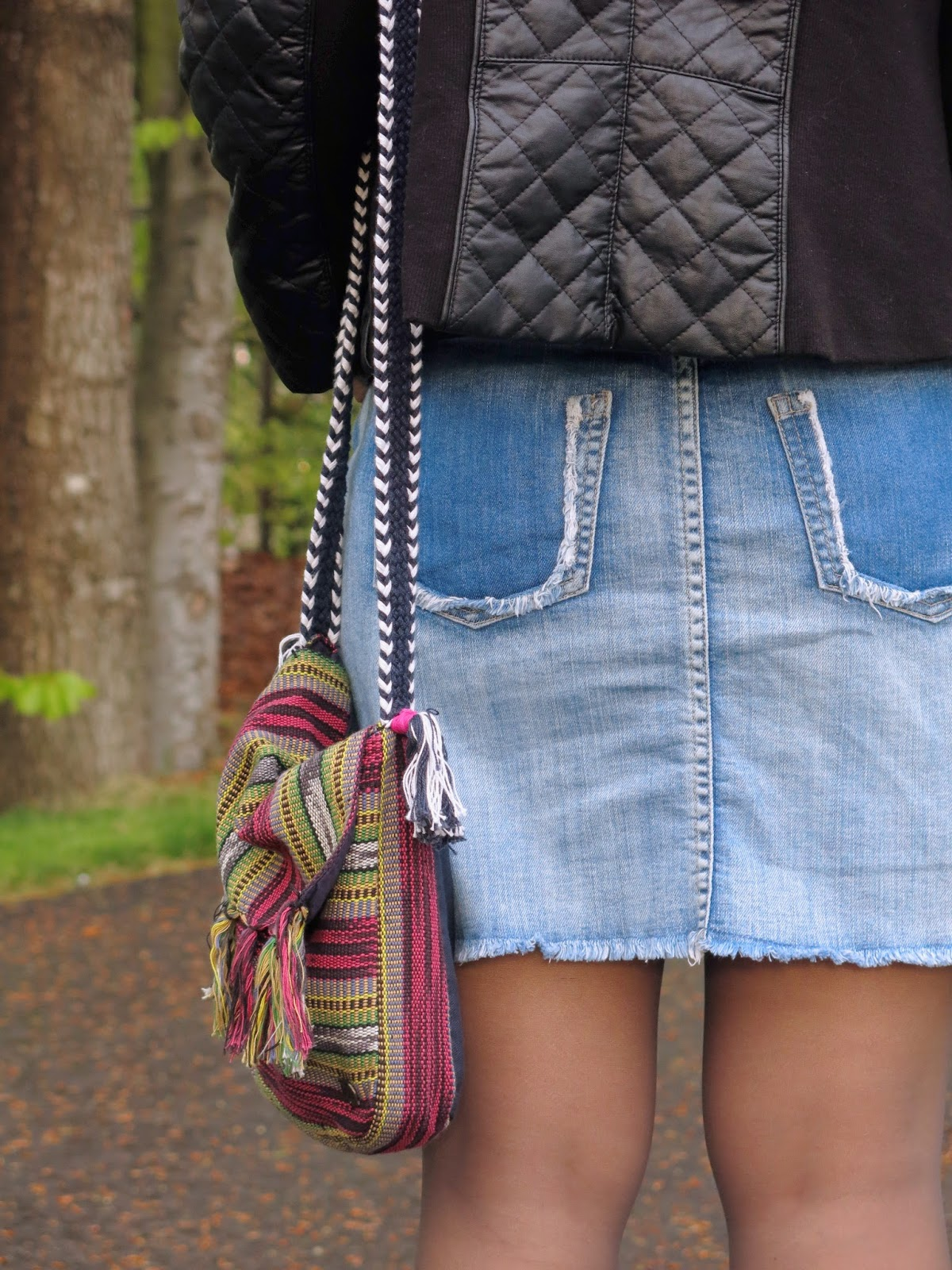 distressed denim mini-skirt with quilted pleather jacket and colourful bag