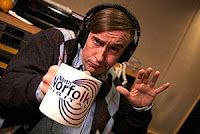 Alan Partridge with North Norfolk Digital mug in hand