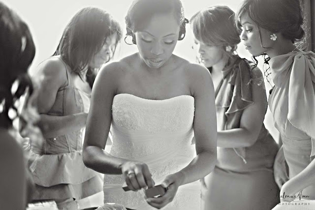 bridesmaids helping bride with dress at St John's Hyde Park wedding