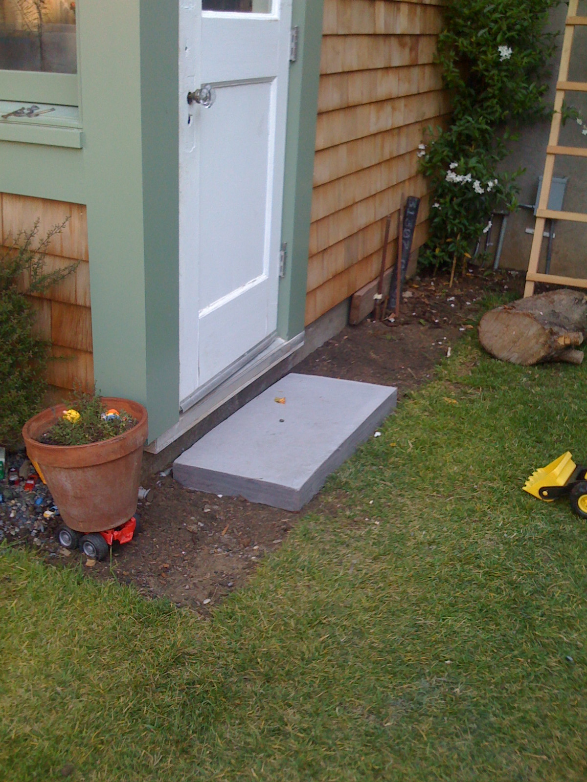 Concrete stoops for all the doors onto the garden. & The Shingled House: Concrete Door Stoops