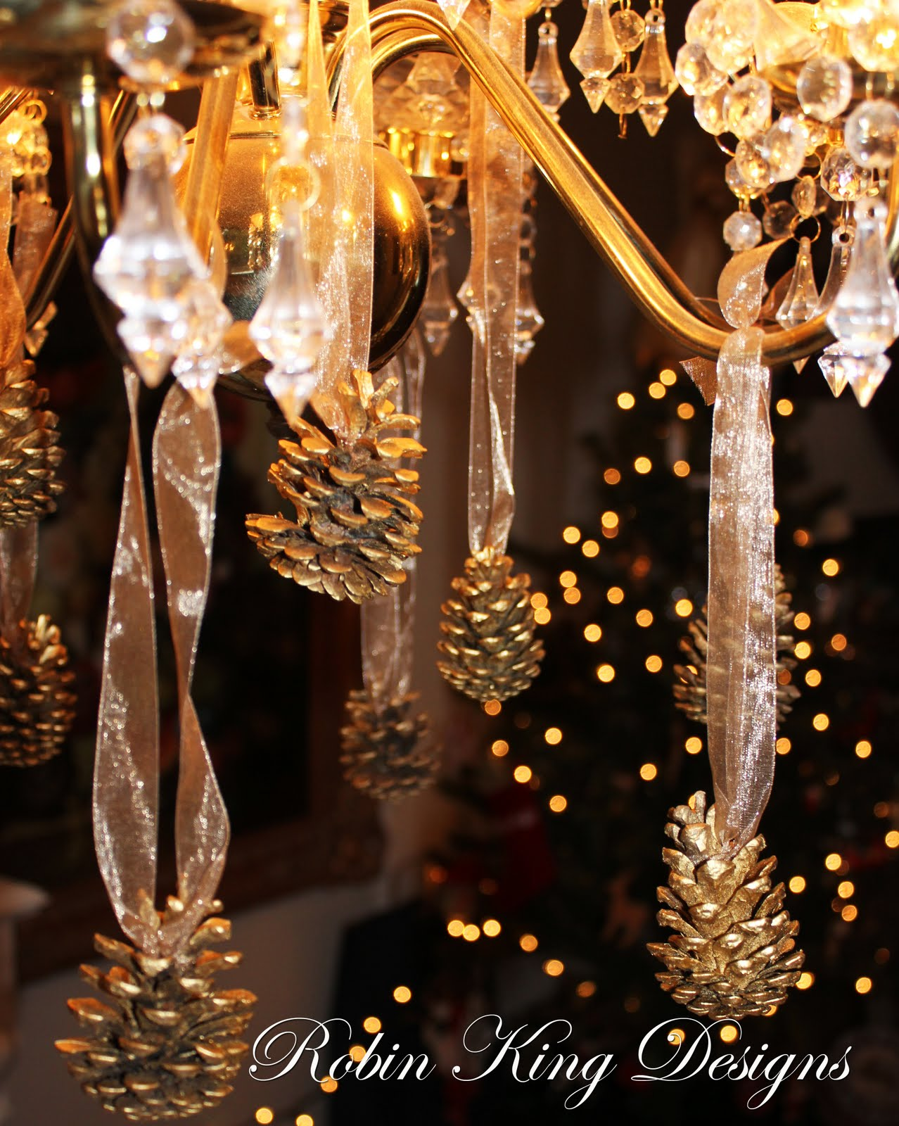 Robin king designs a few beautiful things for christmas these golden pine cones are simply beautiful hanging from a chandelier arubaitofo Gallery
