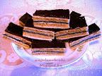 Diós mákos zserbó, karácsonyi sütemény, mákos baracklekváros diós töltelékkel, csokoládémázzal lekenve.