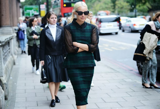 Woman wearing a green Tartan plaid dress on the streets of Paris, France