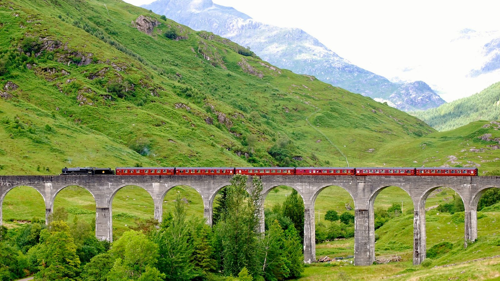 Jacobite steam train passing over the Glenfinnan Viaduct