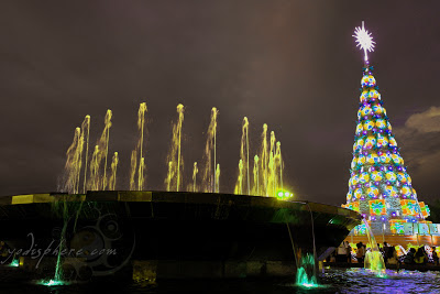 View of water fountain and colorful giant Christmas tree at SM Mall of Asia in San Miguel by the Bay in Manila Philippines