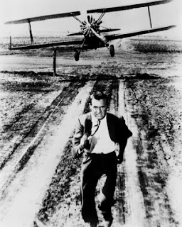 Grant running from plane North by Northwest 1959 movieloversreviews.blogspot.com