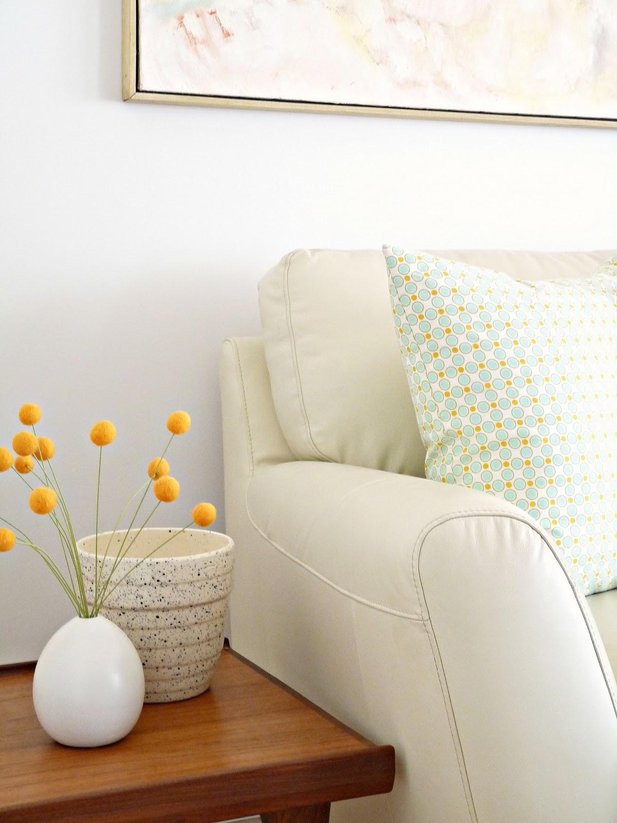 cream leather sofa danish teak side tables