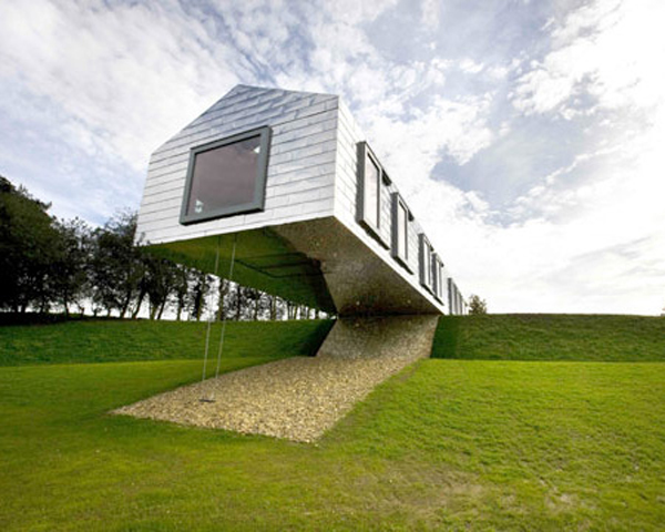 balancing barn this cool house features reflective stainless steel