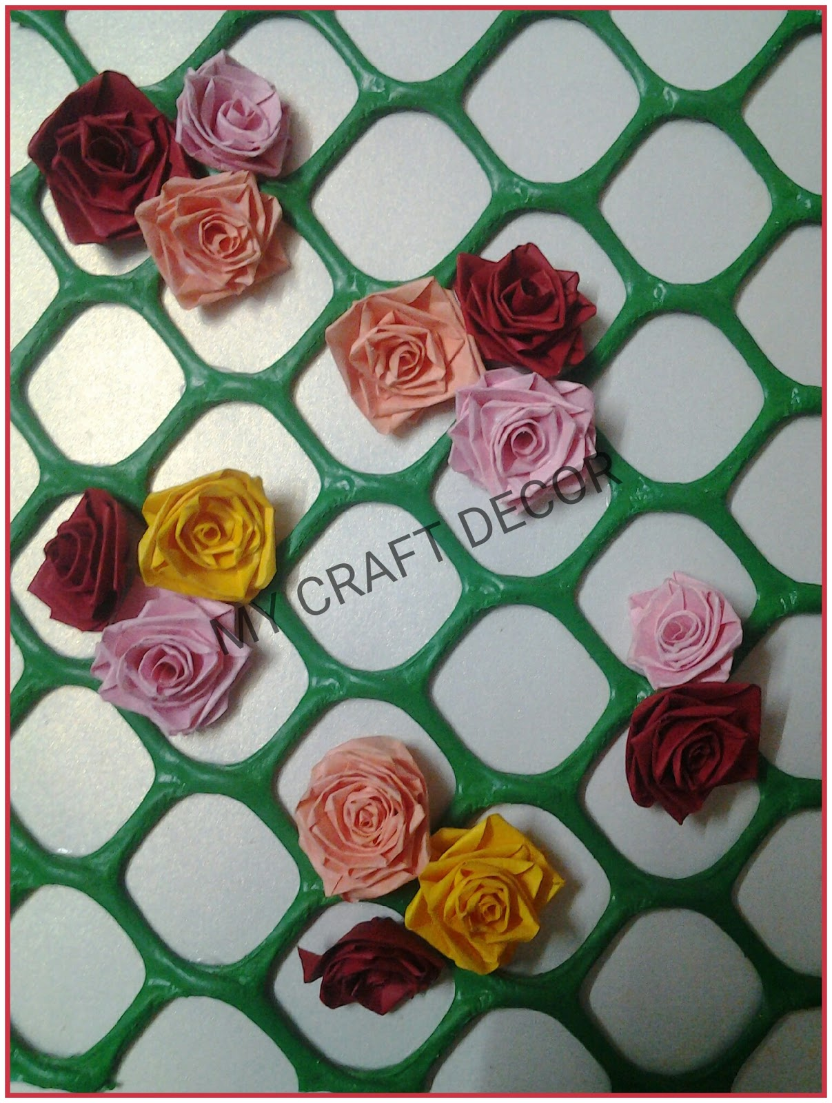 Craft decor quilling roses for back ground i used green mesh and made paper leaves following is basic arrangement of quilled roses mightylinksfo