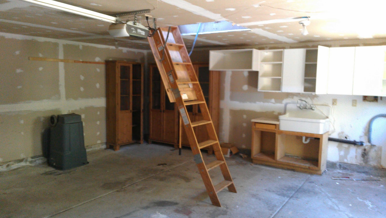 Garage With Ladder To Storage Loft