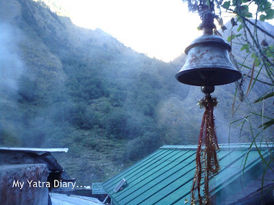 A temple bell hangs in Gangnani, Enroute to Gangotri