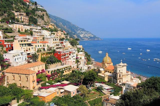 The allure of Positano, Italy, and the Mediterranean Sea beckons in the Summertime! Photo: WikiMedia.org.