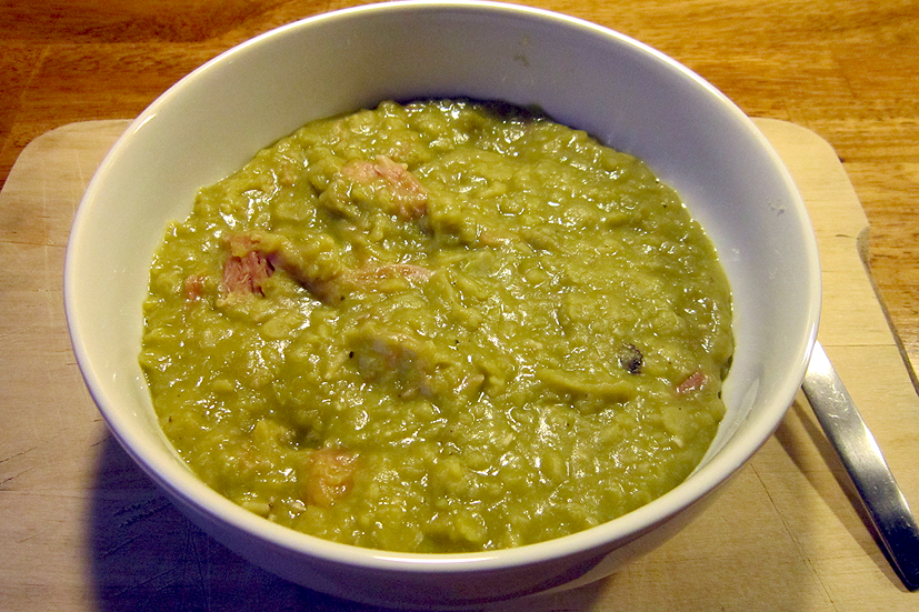 A bowl of pea and ham soup.
