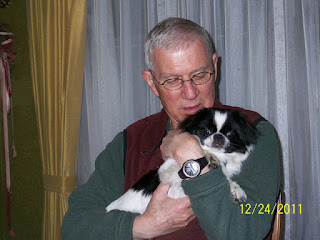 Dad Holding Oliver in 2011 in our Dining Room.