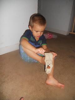putting on socks himself