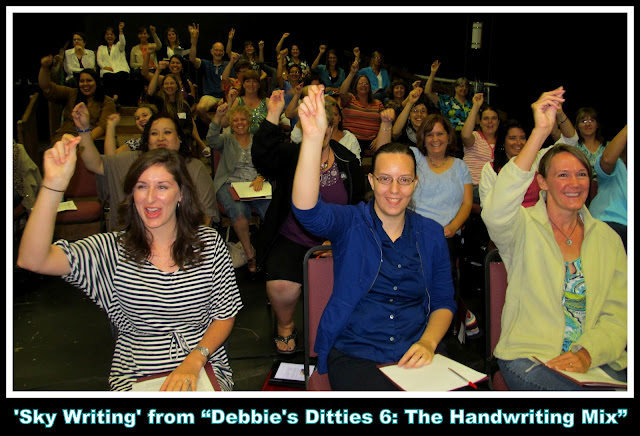 "photo of: Enthusiastic Teachers Sing Debbie Clement's ""Sky Writing"" Song for Fine Motor Development"