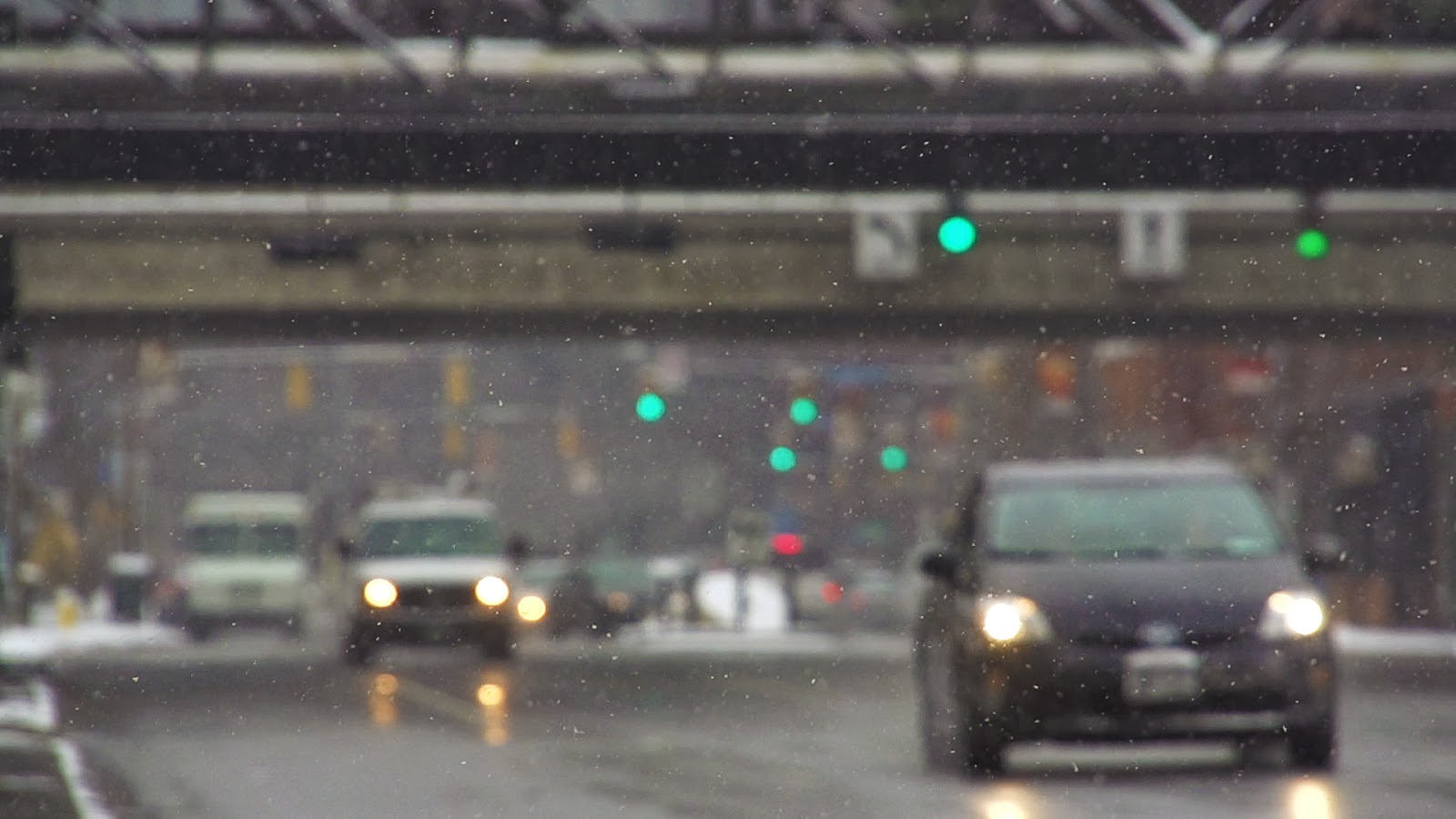 A still image from a stock video clip showing footage of cars driving in the winter.
