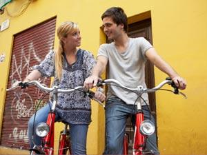 Signs You Are More Than Friends - boy and a girl riding a bike