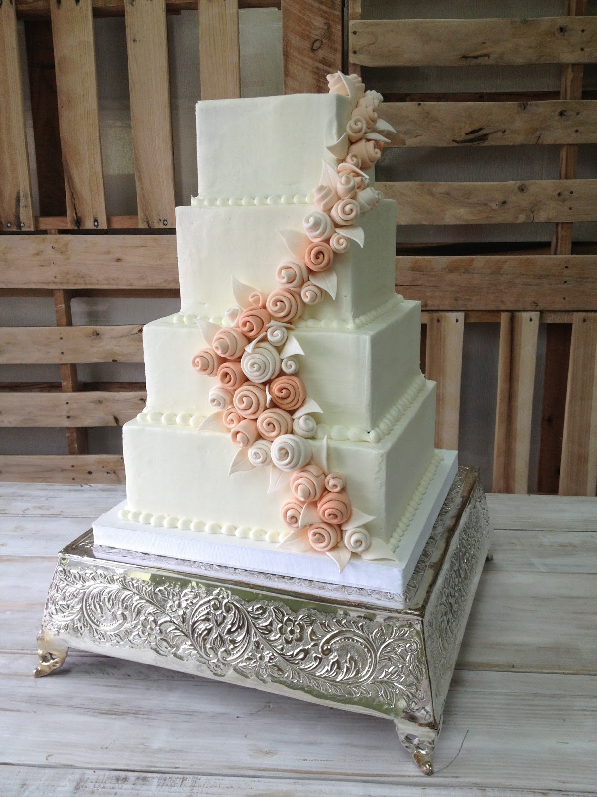 Lindseys Wedding Cake Was Frosted In Vanilla Buttercream And Featured A Winding Cascade Of Whimsical Sugar Roses