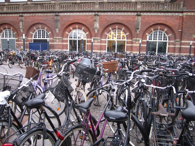 Bicycles outside of train station in Copenhagen, Denmark.