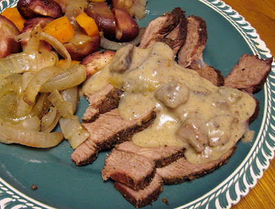 Grilled beef roast with vegetables and gravy