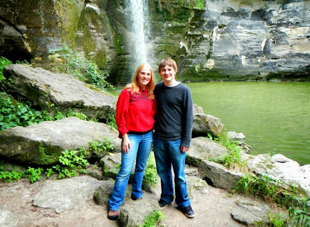 claire and lou at the minneopa state park waterfull during i can camp