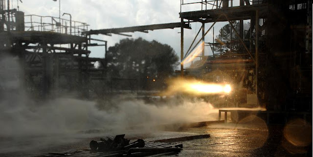 A 3-D printed rocket part blazes to life during a hot-fire test. Image Credit: NASA/MSFC/David Olive