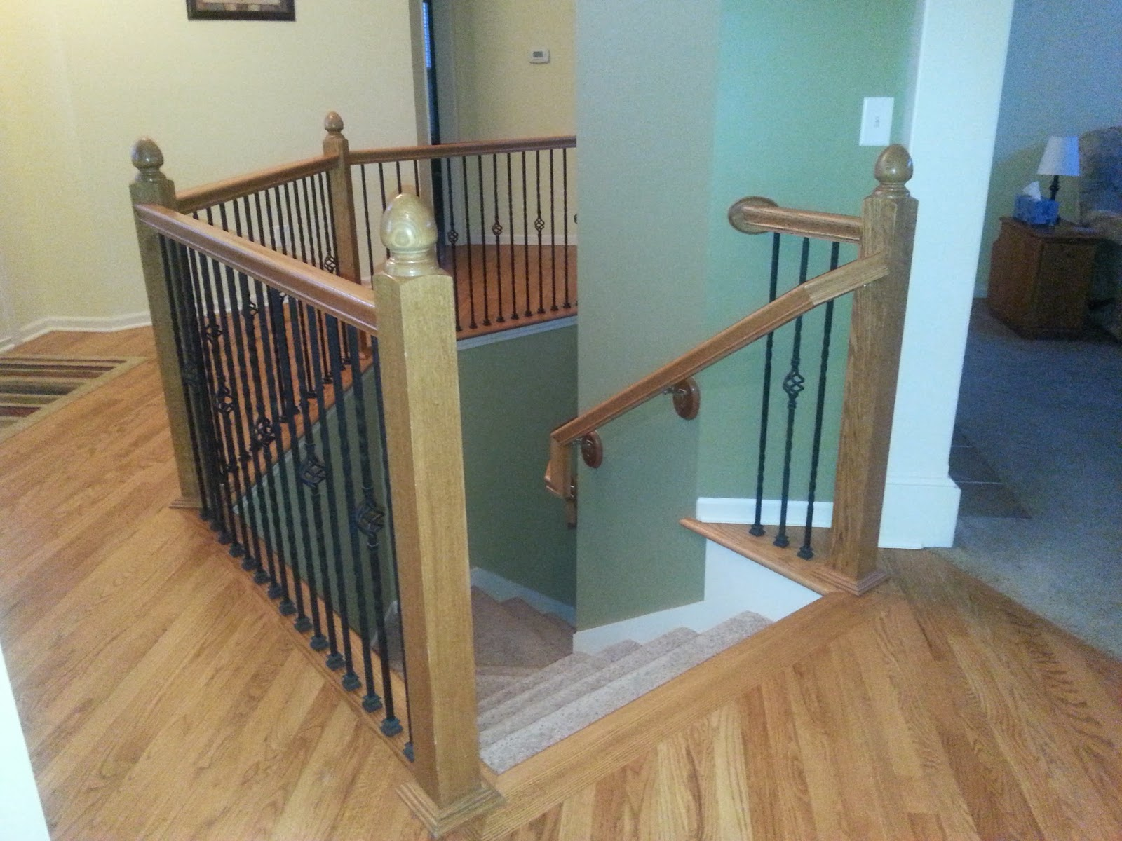 Rod iron spindles on stairway to basement, gardner KS home, Gardner real estate