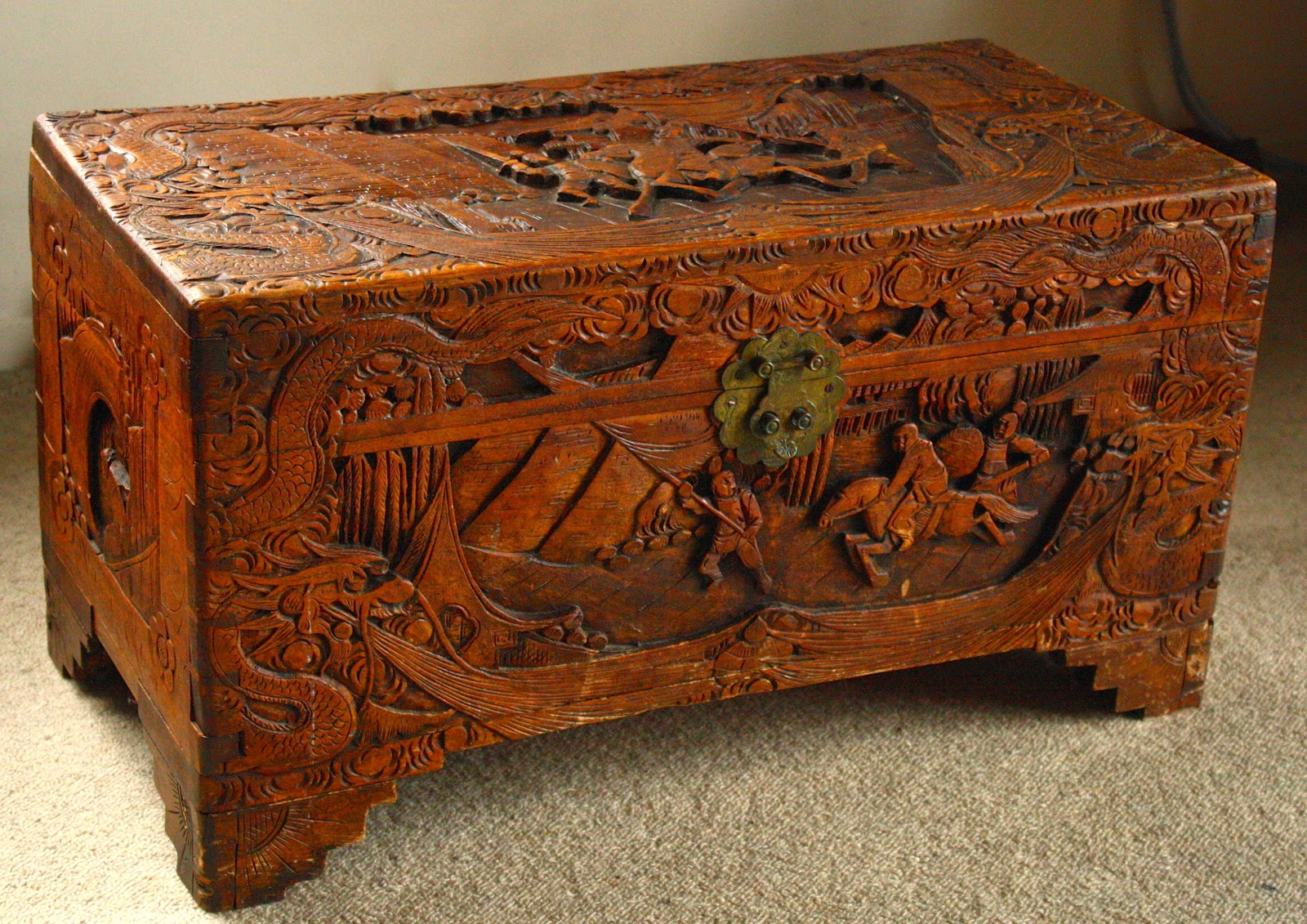 A battered camphorwood chest.
