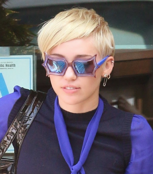 Miley Cyrus wears purple and stylish glasses at lunch