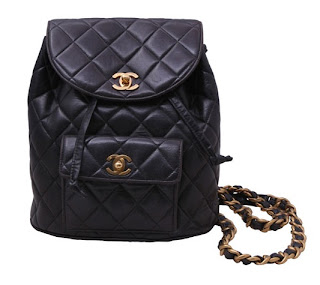 Vintage 1990's Chanel dark brown leather backpack with gold chain straps and gold hardware.
