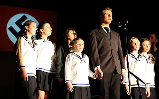 Captain Von Trapp and children singing in farwell concert