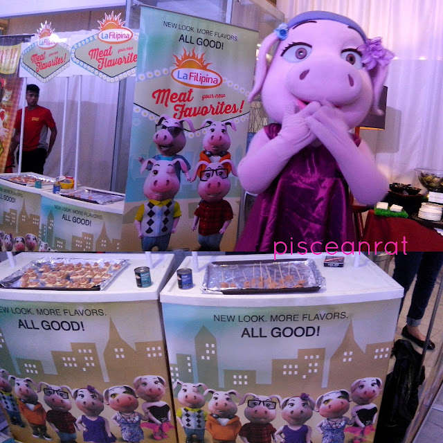 Lia Pig posing in La Filipina sampling booth. The mascot also had a dance number.