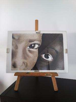 Dos ojos de dos niños africanos a pastel