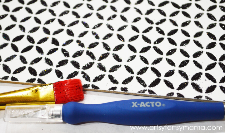 DIY Stenciled Key Hanger at artsyfartsymama.com #ModPodgeRocks