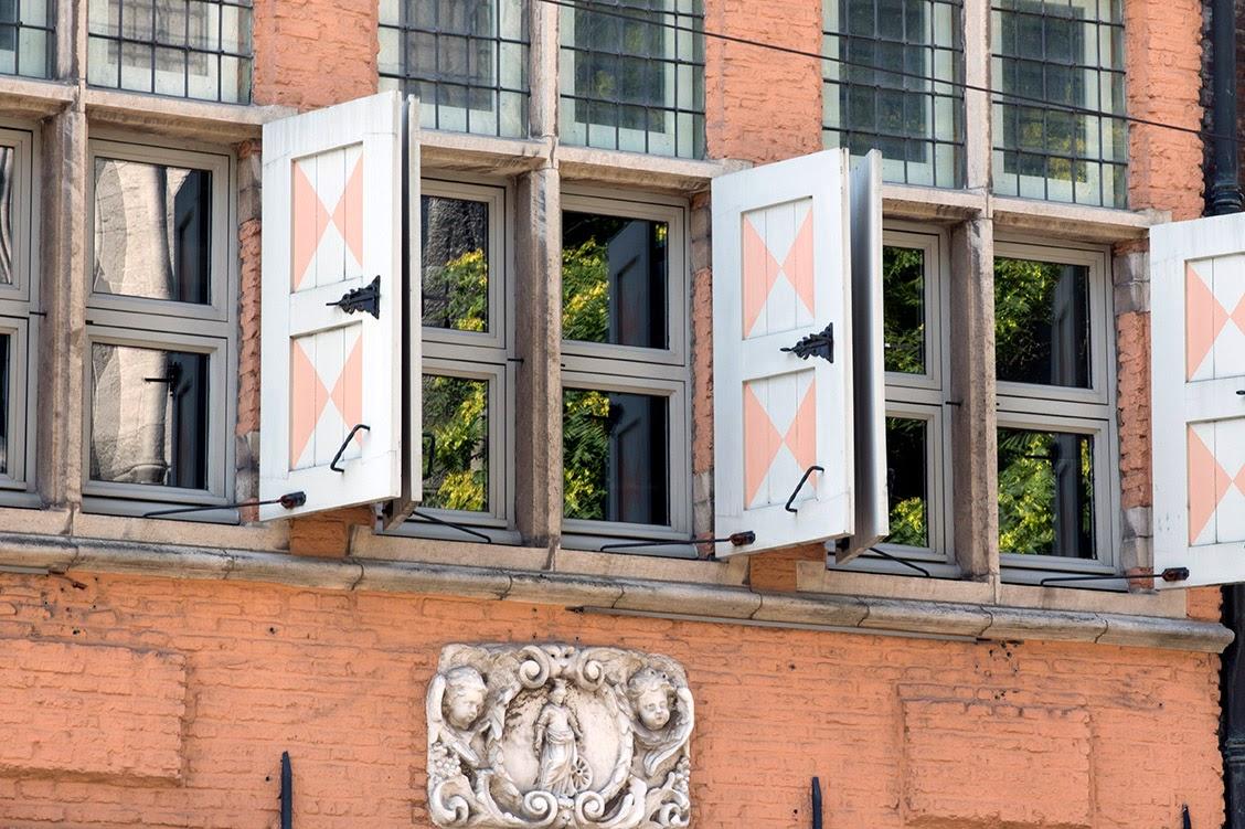 peach coloured shutters and facade