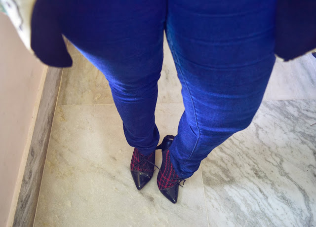 blue jeggings and plaid boots