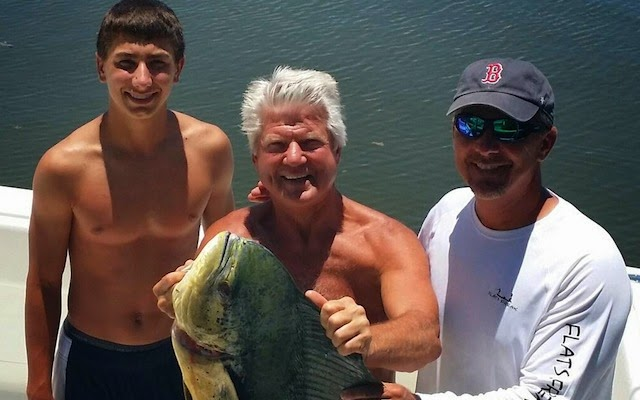 Urban Meyer, his son, a giant fish, and a bare-chested Jimmy Johnson.