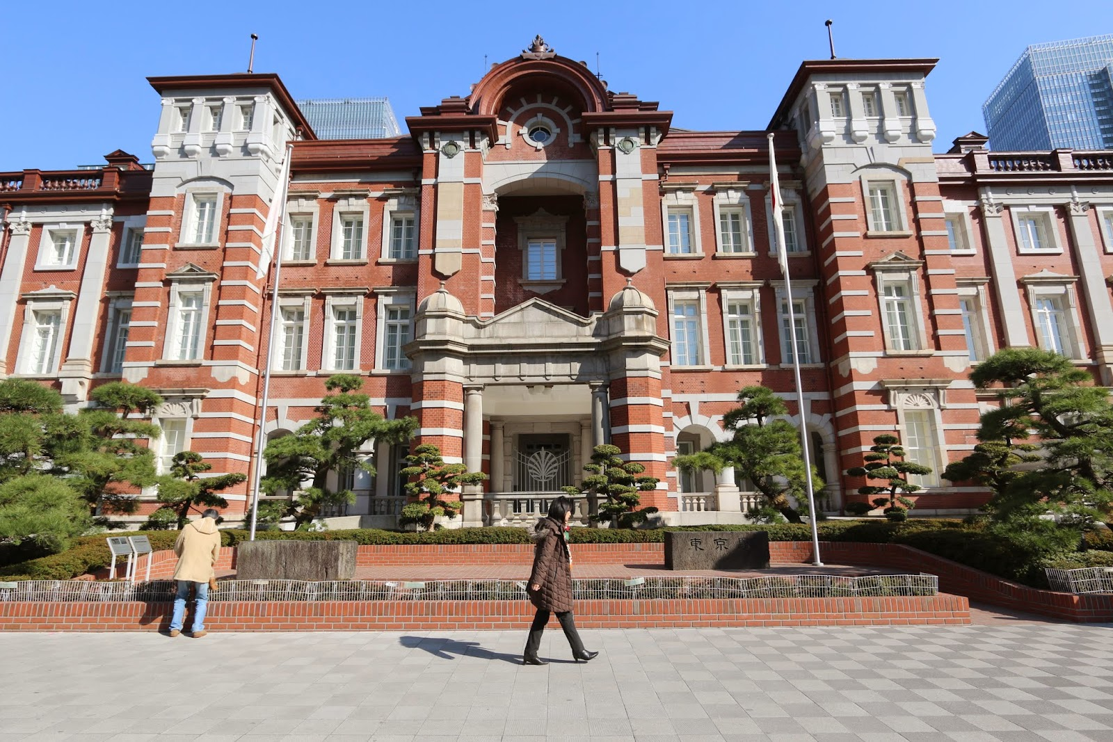 The architecture of Tokyo Station symbolizes the country's modernization and is surrounded by sky scrapers in within Marunouchi in Tokyo, Japan