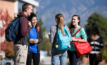 students stand together mingling on the NAU campus